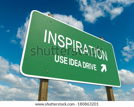 Road sign to inspiration - stock photo