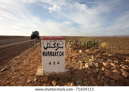 Road Sign to Marrakech in Morocco with blue sky - stock photo