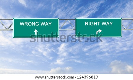 Road sign to right and wrong way - stock photo