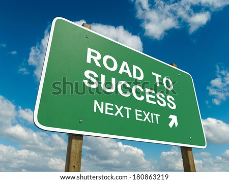 Road sign to success - stock photo