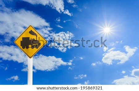 Road sign - train crossing on blue sky and sun - stock photo