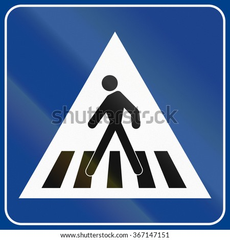 Road sign used in Italy - pedestrian crossing.
