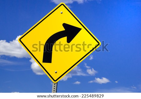 Road Sign Warning of Dangerous Curve Ahead - stock photo