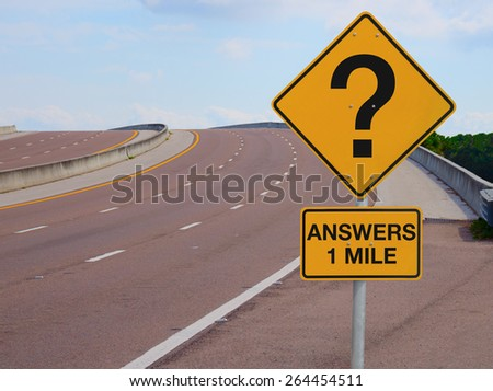 Road sign with a big question mark on it with ANSWERS 1 MILE under the question mark signifying questions in business, finance, life, relationships and many other subjects, with hope for success soon. - stock photo