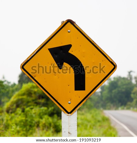 Road sign with arrows - stock photo
