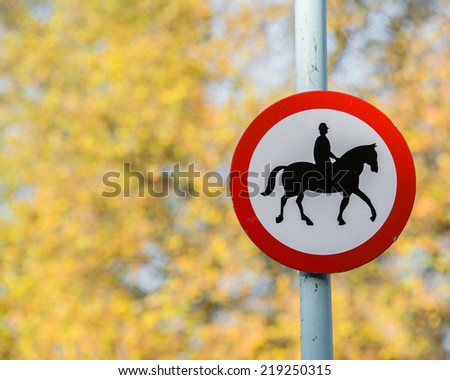 Road sign with horse patrol icon - stock photo