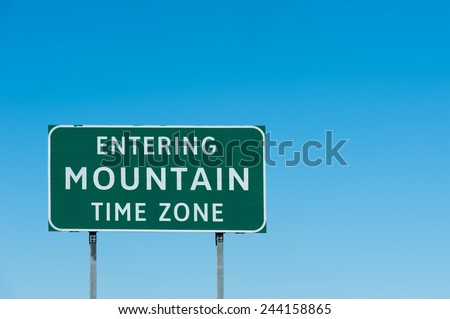 Road sign with Mountain time zone, New Mexico - stock photo