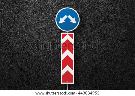 Road sign with pointer on a background of asphalt. Detour. The texture of the tarmac, top view. - stock photo