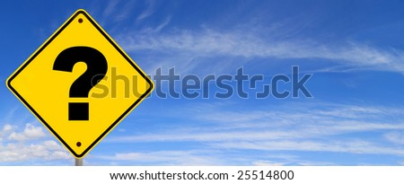 Road sign with question mark, against panoramic blue sky. - stock photo