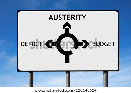 Road sign with roundabout directions pointing towards austerity deficit and budget to illustrate the financial crisis