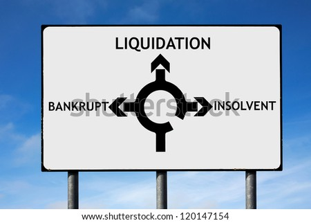 Road sign with roundabout directions pointing towards liquidation bankrupt and insolvent
