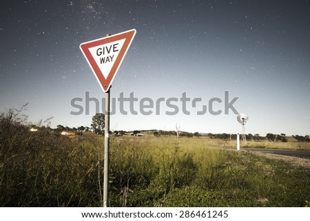 Road sign with stars in the background in the outback of Queensland, Australia. High Noise.