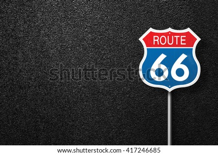Road sign with the words 66. Behind the sign one can see a smooth asphalt road. Route 66. Will Rogers highway. The texture of the tarmac, top view. - stock photo
