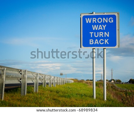 road  sign ' Wrong Way' and blue sky with clouds - stock photo