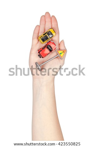 road signs and cars in a hand isolated on white background. driving school concept - stock photo