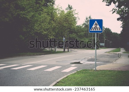road signs and lines on asphalt - retro, vintage style look