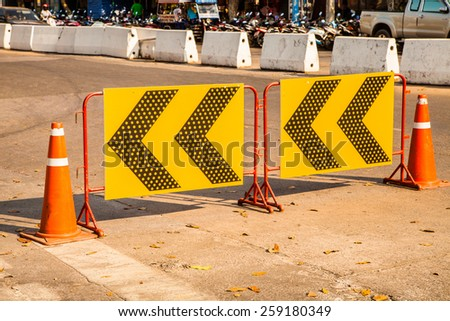 Road signs at the end of the road pointing left  - stock photo