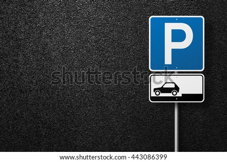 Road signs. Behind the signs one can see a smooth asphalt road. Parking. The texture of the tarmac, top view. - stock photo
