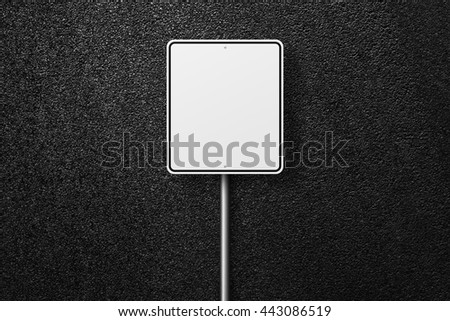 Road signs. Blank road signs. Behind the signs one can see a smooth asphalt road. The texture of the tarmac, top view. - stock photo