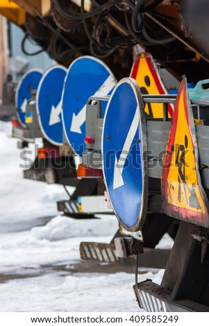 Road signs. directional and warning signs on the road cars. - stock photo