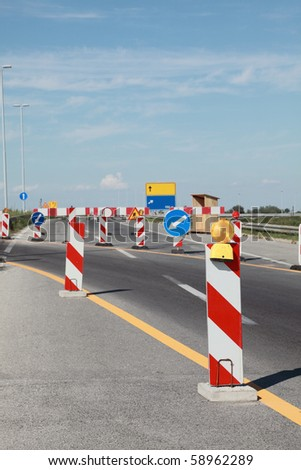 Road signs in a highway on reconstruction - stock photo