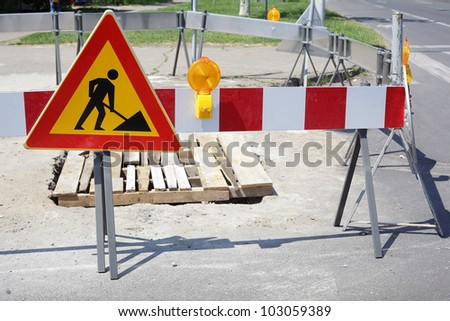 Road signs in a street under reconstruction - stock photo