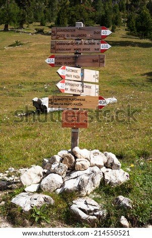 road signs in the mountains of Alto Adige, Italy - stock photo
