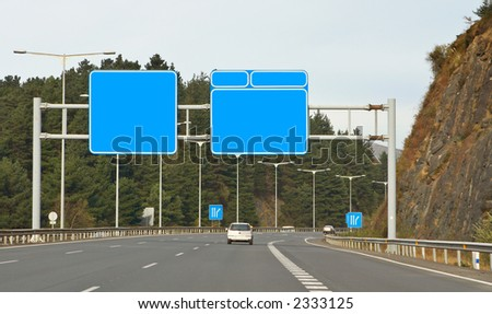 Road signs over the cloudy autumn sky - stock photo
