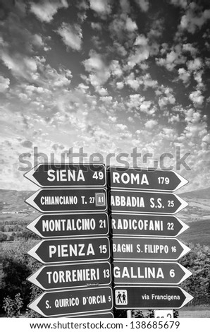 Road signs pointing different directions in Tuscany, Italy - stock photo