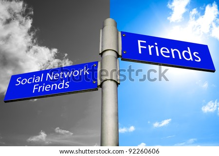"road signs showing ""social network friends"" and (real) ""friends"" - concept"