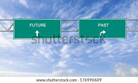 Road signs to future and past - stock photo