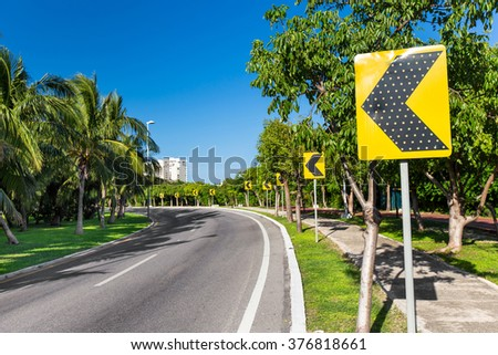 Road signs warning drivers about ahead dangerous curve 