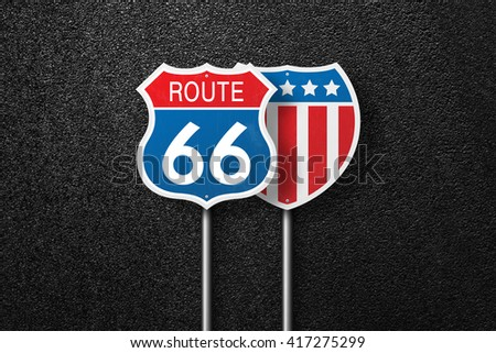 Road signs with the words 66 and USA flag are placed in a row on a background of asphalt. Route 66. Will Rogers highway. The texture of the tarmac, top view.