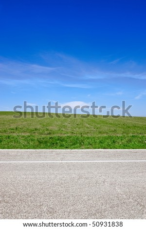 Road, sky and grass - stock photo