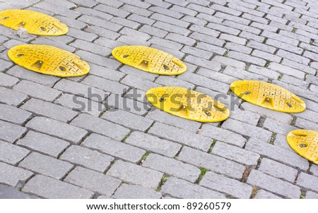 Road speed bump - a safety restriction to prevent people from fast driving - stock photo