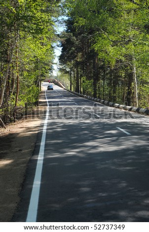 Road, speed, weather and fine landscape - stock photo
