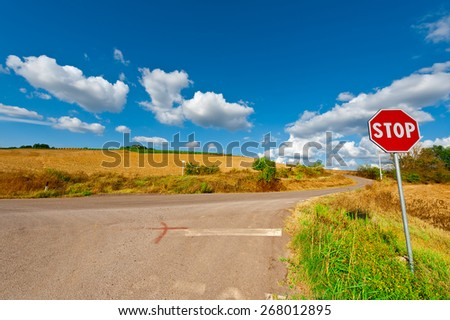 Road Stop Sign before the Intersection in Tuscany, Italy - stock photo