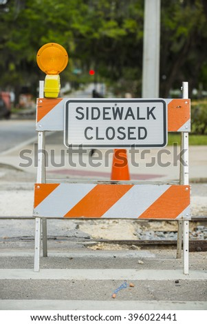 Road street construction zone warning hazard sign sidewalk close - stock photo