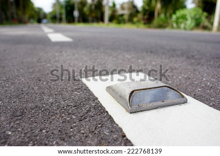 road stud with white reflector - stock photo