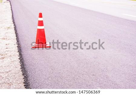 road surface repairing works / traffic cones  - stock photo