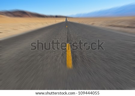 Road that goes to the horizon with motion blur applied - stock photo