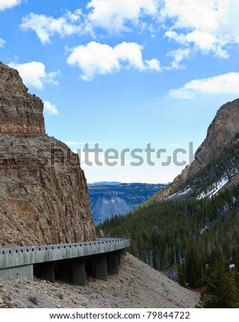 Road Through a Mountain Pass in Yellowstone National park - stock photo