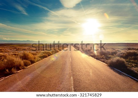 Road through landscape. Road and car travel scenic and sunset.Road travel concept.Car travel adventures. - stock photo