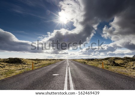 Road through lava field, near village Vik, South Iceland - stock photo
