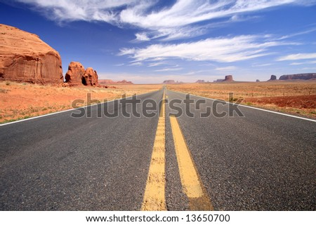 Road through Monument Valley, Arizona - stock photo