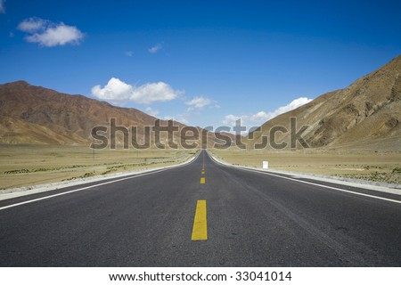 road through mountains in tibet, china - stock photo