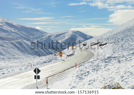 Road Through Snowy Mountains. Crown Range Road, South Island, New Zealand - stock photo
