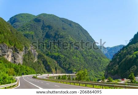 road through the Alps - stock photo