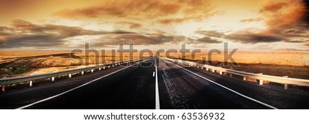 Road through the desert - stock photo