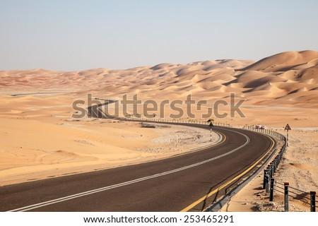 Road through the desert to the Moreeb dune in Liwa Oasis, Emirate of Abu Dhabi, UAE - stock photo